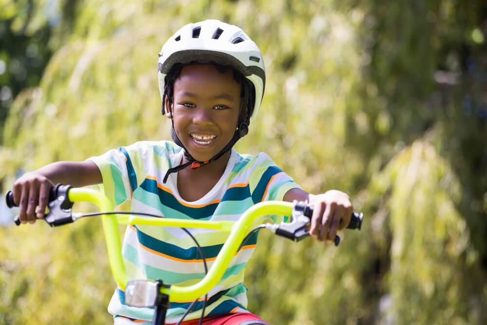 happy kid on bike
