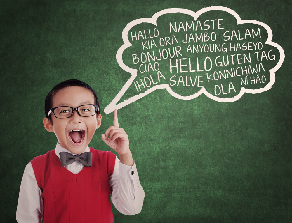 Kid with speech bubble with several foreign words